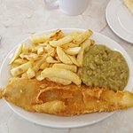 Pablo's Special Cod in crispy Batter Chips and Mushy peas