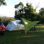 Our tent overlooking the hedge and rolling hills