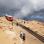 Clouds Rolling In - Summit of Pike's Peak with Railway Cars in Station.