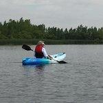 A quiet kayak trip along the shore.