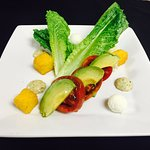 Heirloom Tomato, avocado and goat cheese salad with polenta croutons and pesto dressing