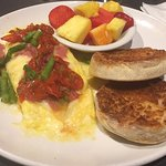 Prosciutto omelette with fruit and English muffin