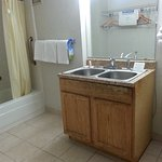 Who builds a double kitchen sink in a bathroom?