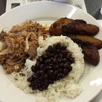 Lechon asado, black beans and rice, plaintains