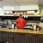 """The sign above the griddle reads, """"No WiFi. Talk amongst yourselves."""""""