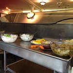 The entire trolley of side dishes/salad to your table