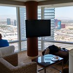 Living room with views towards I-15 and Rio Hotel.