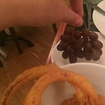 There were at least some fresh grapes on the salad. We also ordered onion rings.
