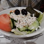 A salad starter as part of a Greek meal.