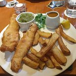 Fish chips mushy peas and curry sauce