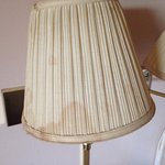 Stains on wall-mounted lamp shades. These lights did not function as they were unplugged.