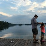 The view from the dock, which is just gorgeous, with my husband and daughter having fun.