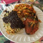Árroz con frijoles, baked squash y máiz, stuffed chili pepper.
