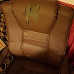Office chair in the room that is falling apart. Chair should be replaced.
