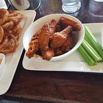 The buffalo wings and onion rings