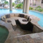 Pool surrounding sunken couch