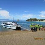 Happy holiday makers boarding a seashuttle at Kaiterteri Beach