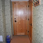 door to adjacent room-closet door-foot of bed