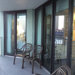 Double door access to private balcony w/ 4 chairs & table