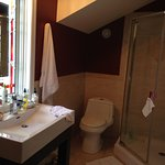 The Birch Room. Bright, spacious ensuite bathroom with shower & tub.