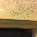 gang tags carved into door molding