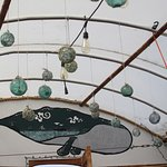Decore of fishing floats in the glassed roof eating area.