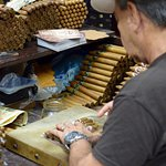 Man rolling cigars at the cigar shop we went to