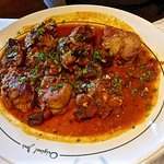 sweetbreads with tomato sauce ...... nicely done.  not that common to see these on a menu these