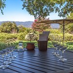 Porch Table set for wine tasting.