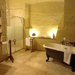 How about this for a luxury bathroom in a cave. The walls are hewn from the rock!