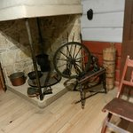 cooking area with spindle, churn, and chair to the side