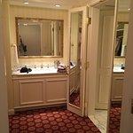 Dressing area w/ sink, mirrors, closet, iron & board
