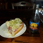 Half of my small Italian sub.  Great sandwich, interesting decor, friendly service. Definitely w