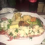 Lobster with Rice, fried plantains, salad, potatoes and provision.