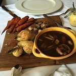 Baby potatoes roasted in duck fat, glazed carrots, mushrooms, and a port and onion jus