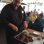 Owner Martin Lombard carves our steak