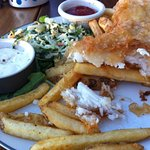 The halibut was crisp but still moist inside, served on a warmed plate. Chips were perfect.