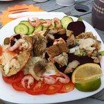 Crab, mackerel, shrimp, prawn, crayfish tails, cockles, anchovies etc! A Royale salad indeed.