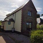 صورة فوتوغرافية لـ Newbarn Farm Cottages & Angling Centre