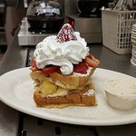 Stuffed French toast with an extra side of sweet cream cheese  (Pinapple,Banana,Strawberries &Bl