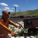Copper pickaxe dude and a mine cart.