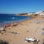 Albureria old town beach. 8 Euros in a taxi. 15 euros a day for 2 sunbeds.