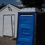 The blue thing is the portable toilet they expect you to use; no hand-wash sink.