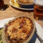 Homemade Steak & Ale pie and Chicken & mushroom pie both served with chips/mash...