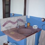 Baño estilo rustico, con bañera hidromasaje