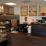 This is one of the owners in the area where all the specility beverages are made. You & Pastry c