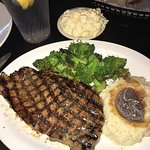 14ounce ribeye with wood grilled broccoli and mashed potatoes and gravy along with Mac and chees