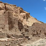 Pueblo Bonita nestled against the cliff, part of which collapsed in the 1940s.