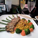 steak and lo mein and vegetables