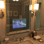 TV behind the mirror in the bathroom